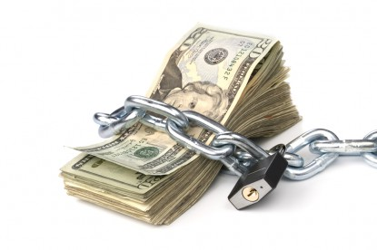 stack of 20 dollar bills wrap with chain and pad lock
